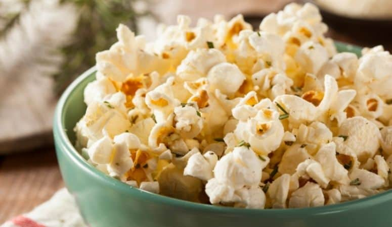 Make toppings stick to oil-free popcorn