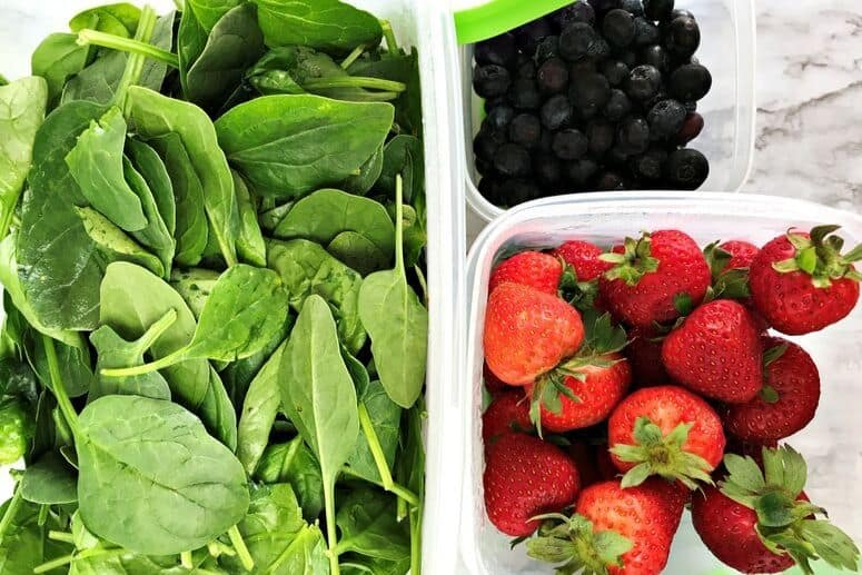 Spinach, strawberries, and blueberries in Rubbermaid FreshWorks containers