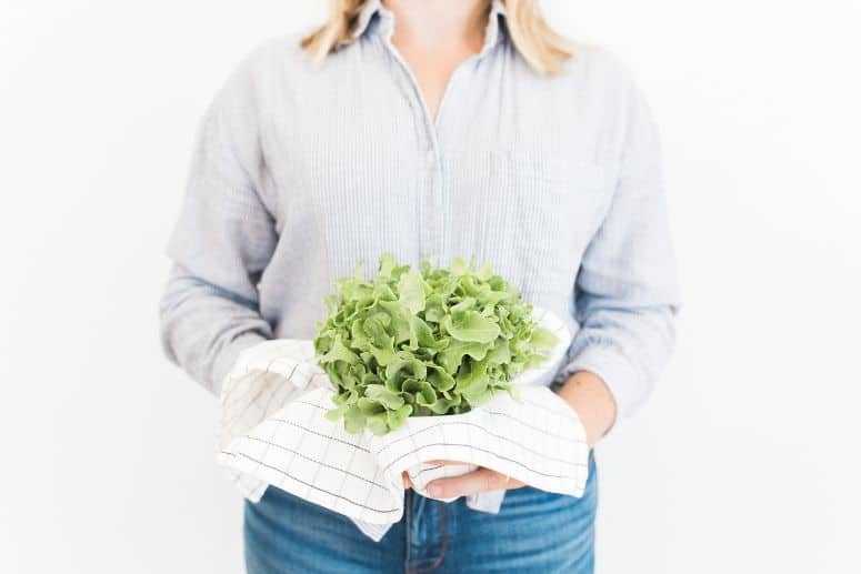 Woman holding leafy greens