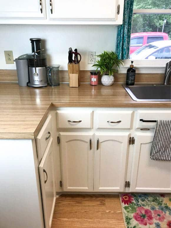 white kitchen cabinets with woodgrain formica