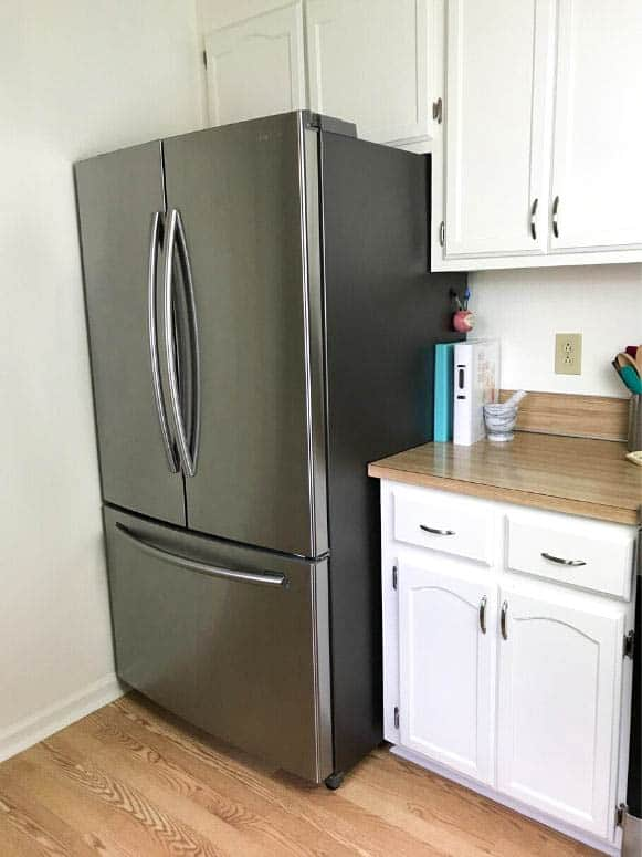 white kitchen with stainless french door refrigerator