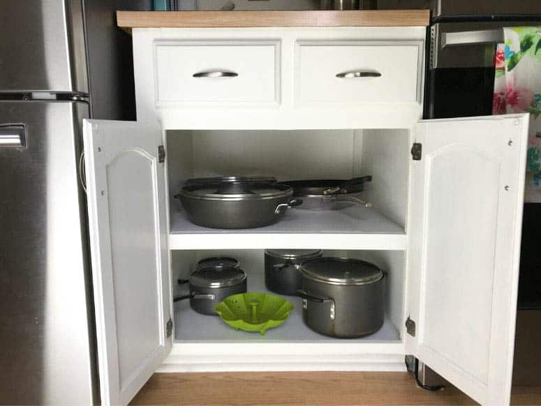 white kitchen cabinetry for pots and pans